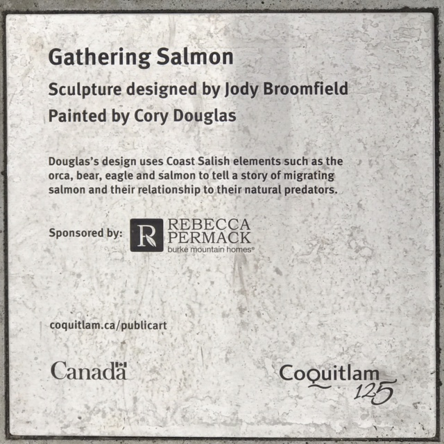 Becca and the Salmon Plaque.JPG