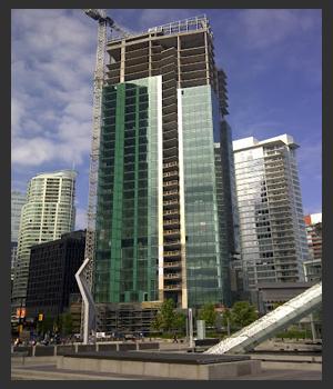 Three Harbour Green Grey Building Vancouver Penthouse Ian Watt Active Condos.jpg
