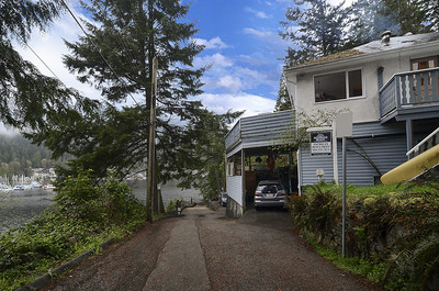 Deep Cove semi-waterfront living at its best!