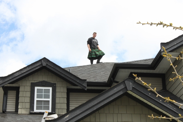 Men in Kilts posing on the roof top