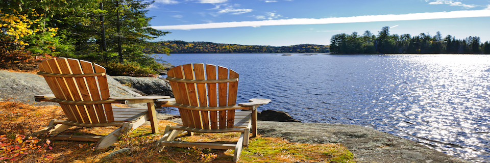 Peninsula, Muskoka Lake cottage with chair