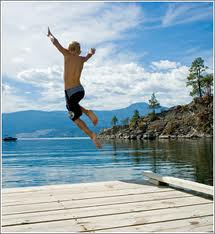 Kid jumping into lake